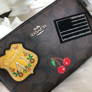 Coach LG Wristlet 19 In Signature Canvas (Patches)